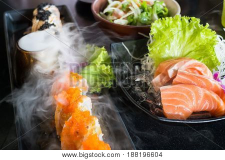 Set Of Salmon Menu Served On Black Plate stock photo
