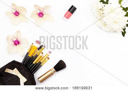 Flowers Orchid And Chrysanthemum, Makeup Brushes And Nail Polish On White Background. Minimal Beauty