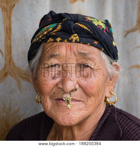 KATHMANDU NEPAL - SEPTEMBER 29 2016 : Portrait old women in traditional dress in street Kathmandu Nepal