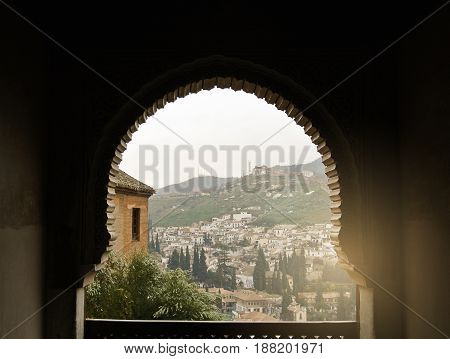 Granada, Spain - February 10, 2015: A View To Old White Houses Of Granada Over The Hill Through A De