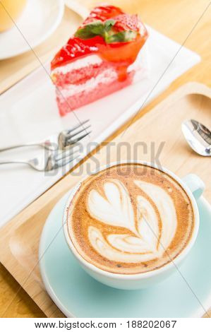 coffee heart cup and cake on wood table in coffe shop cafe