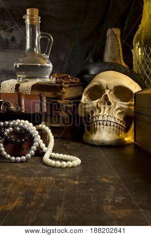 Human skull and ancient books still life