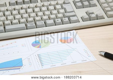 Business concept. Charts, diagrams, tables with computer keyboard.  Workplace for the business person.
