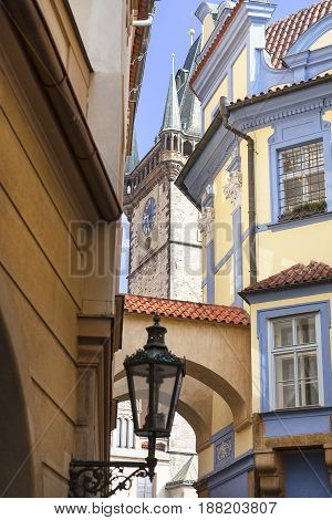 Narrow street with lantern view on tower of Old Town Hall Prague Czech Republic Europe