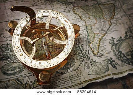 Close-up View Of A Vintage Compass On An Old Retro Map