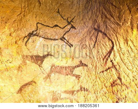 Discovery of prehistoric paint of caveman hunt in sandstone cave. Paint of human hunting of deers mammoth and reindeer. Spotlight shines on historical black carbon abstract art in sandstone cave poster