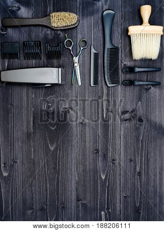 Hairdresser Tools On Wooden Background. Top View On Wooden Table With Scissors, Comb, Hairbrushes An