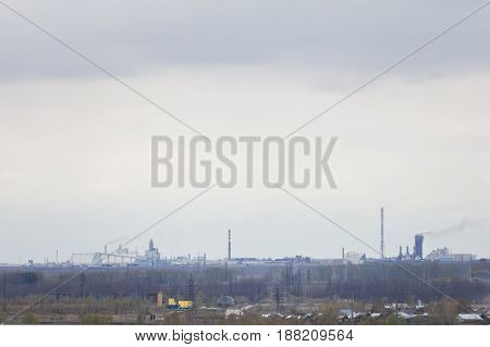 The image of a landscape, industrial enterprise near the village