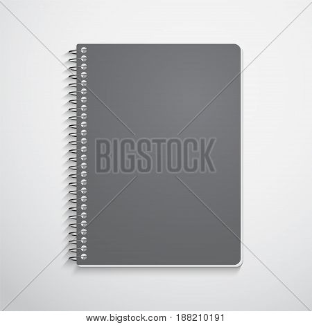 Realistic spiral notebook  with black cover isolated on white. Vector