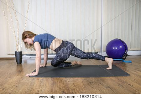 Muscular Woman Doing Intense Core Workout.  Working on abdominal muscles.