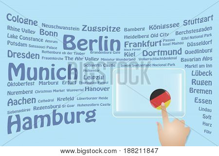 Hand is touching a round German flag on a transparent screen. The blue bent names of the German sights are in the background. Free place for your text is at the screen.