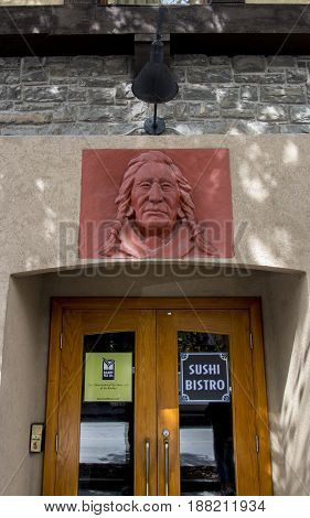 Banff Alberta/Canada - August 31 2015: An indigenous indian design on a building in Banff Alberta.