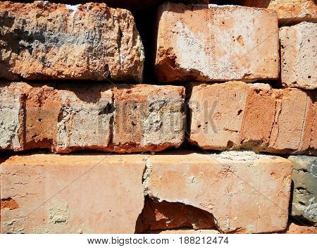 Abstract texture brick yellow color background stone,structure lined with granite walls sandstone background bricks wall.Facing stones for decor house.Brick old walls natural dilapidated style cement.