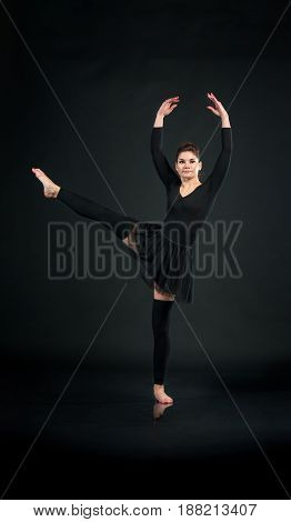 sporty woman standing graceful on one leg.
