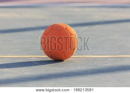 Children's rubber soccer ball on the court