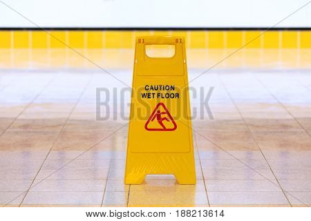 A Wet floor yellow color caution sign