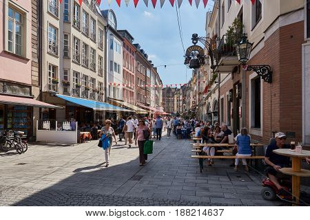 DUESSELDORF, GERMANY - AUGUST 17, 2016: Duesseldorf Altstadt is famous for its historic facades and nomerous bars and restaurants