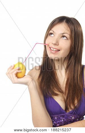 studio portrait of young healthy attractive woman drinking fresh lemon through coctail tube isolated against white background