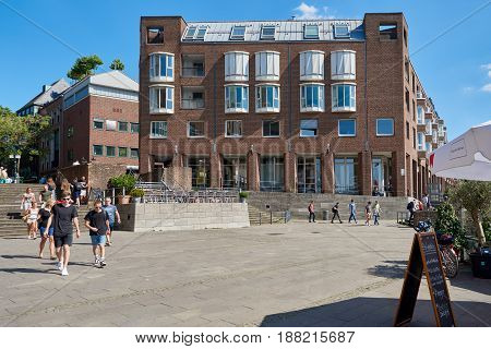 DUESSELDORF, GERMANY - AUGUST 17, 2016: A modern building in the Altstadt combines historice brick facade with modern style