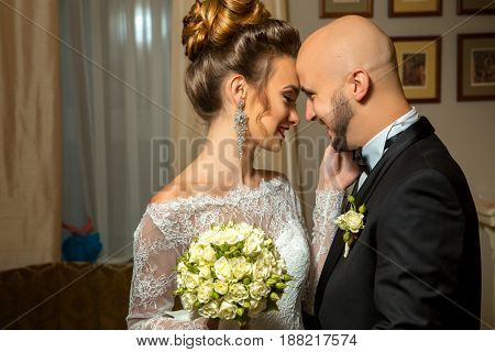 portrait of young just merried couple in love hugging and smiling to each others
