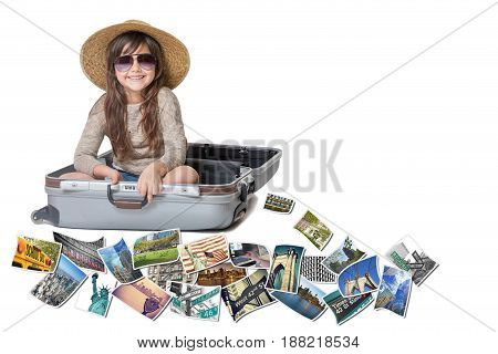 Long haired little girl with straw hat is sitting in a open suitcase. Photos of the sights of New York City (USA) flies around the suitcase. All is on the white background. Horizontally.