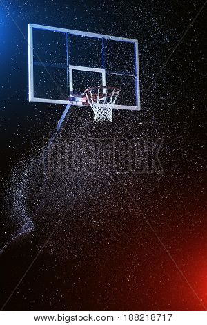 Basketball hoop isolated on black background under rain.