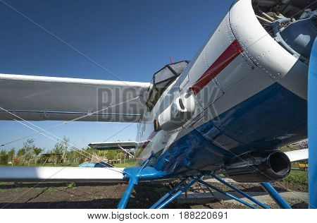 white and blue biplane front view close-up view