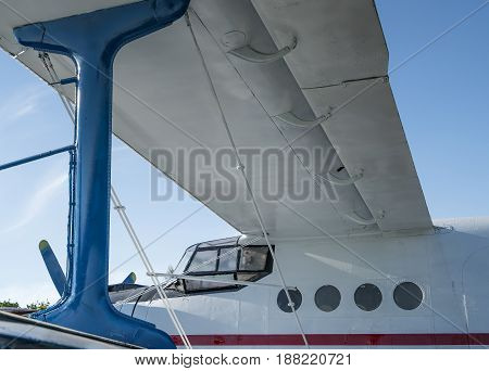 white and blue biplane side close-up view