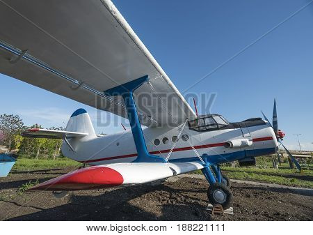 biplane side close-up view with blue sky