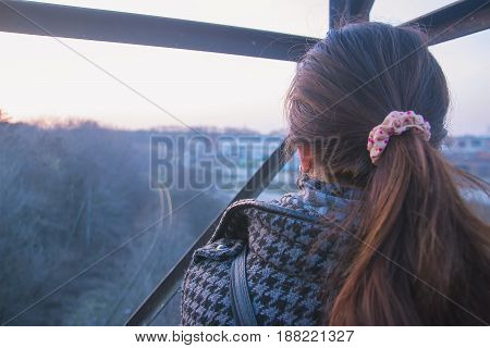girl sits on the rig at evening