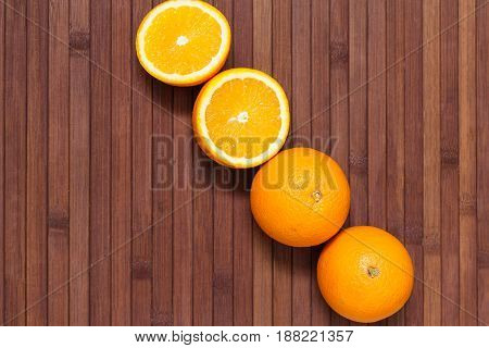 Fresh orange fruits isolated on wooden background. Healthy food. A mix of fresh fruit. Group of citrus fruits. Vegetarian raw fruit. Nutrition for a healthy lifestyle.