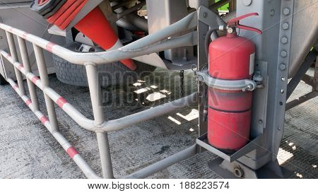 One Red Tank Of Fire Extinguishers Or Emergency Equipment Under The Oil Tanker Truck Or Gas Tanker T