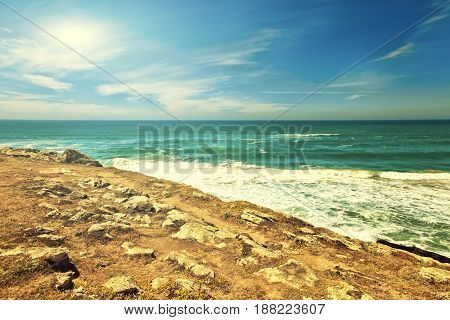 Cliffs and rocks on the Atlantic ocean coast in Sintra in a beautiful summer day. Portugal