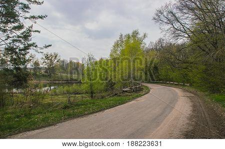 Bad asphalt road at the rural landscape