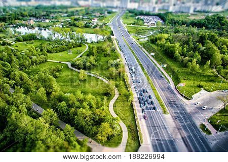 Top view of the the road in city, Green park on the sides