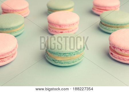 Assortment of sweet pastel color macaroons in rows