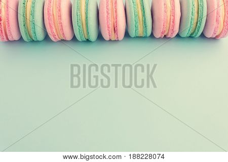 Sweet colorful macaroons in row with copy space. Flat lay. Top view
