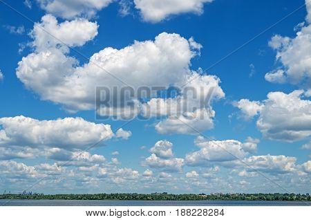 Lower cloudiness with large cumulus clouds over the river in middle of spring