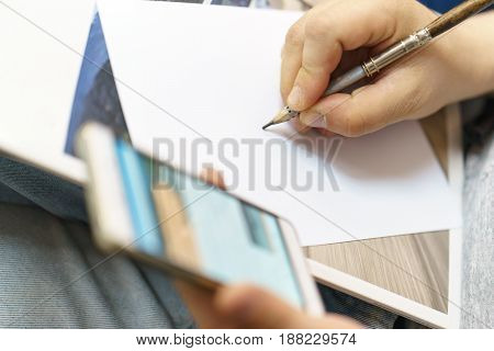 a man writes a pencil on white paper
