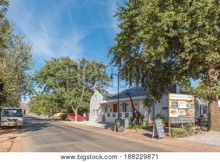 GREYTON SOUTH AFRICA - MARCH 27 2017: A street scene with a restaurant and giraffe statue in Greyton a small town in the Western Cape Province of South Africa