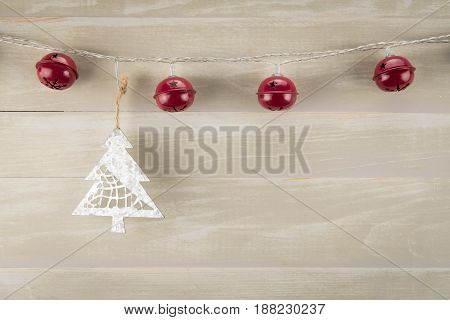 Red Bells with Metal Pine Tree and copy space on neutral background
