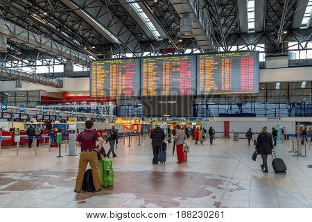 Prague, Czech Republic - March 21, 2017: People waiting in front of the flight information panel at Prague International Airport