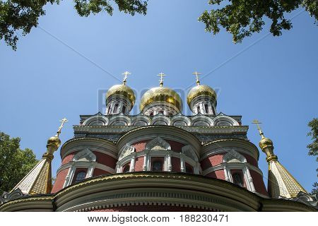 golden church dome on blue sky front fiew