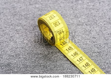 Tape For Measuring On Grey Cloth Surface