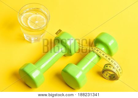 Remedy For Weight Concept. Squeezed Glass Of Citrus, Dumbbells, Centimeter