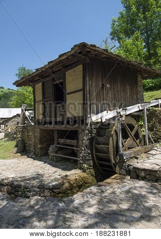 old water mill in the mountain day time