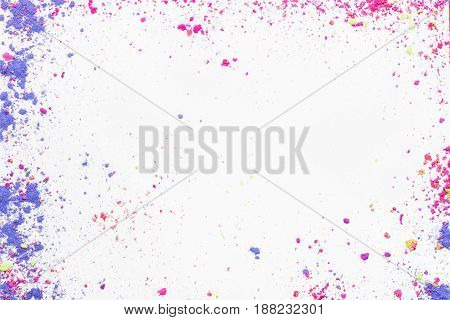 White background with colorful make-up powder with copyspace. Makeup template background. Flat lay, Top view