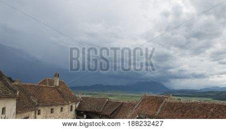 old houses roof in a clowdy sky