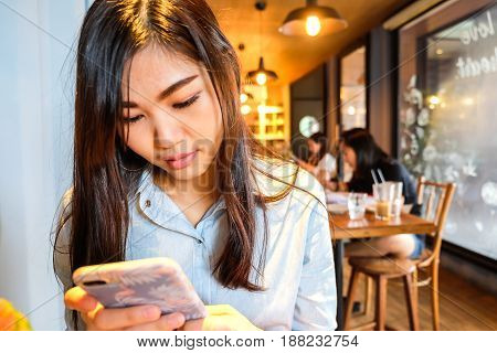 Beautiful Women Using Cellphone For Social Media And Play Game