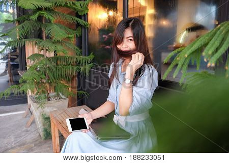 Business Women Using Cellphone Sitting In Vintage Cafe